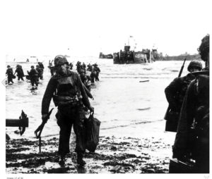 American assault troops move onto Utah Beach, 6 June 1944.