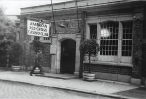 "Where it all began: The American Red Cross Casino Club in Namur, Belgium, 1945, where Hubbard and 2 other American soldiers were invited ""to visit in a nice Belgian home for the night."""